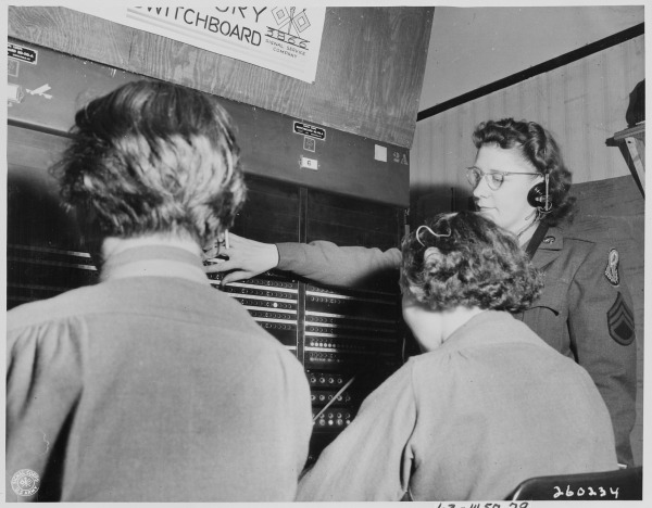 S._Sgt._Lorraine_Robitaille,_switchboard_supervisor,_from_Duluth,_Minnesota,_looks_down_the_line_of_the_Victory..._-_NARA_-_199009